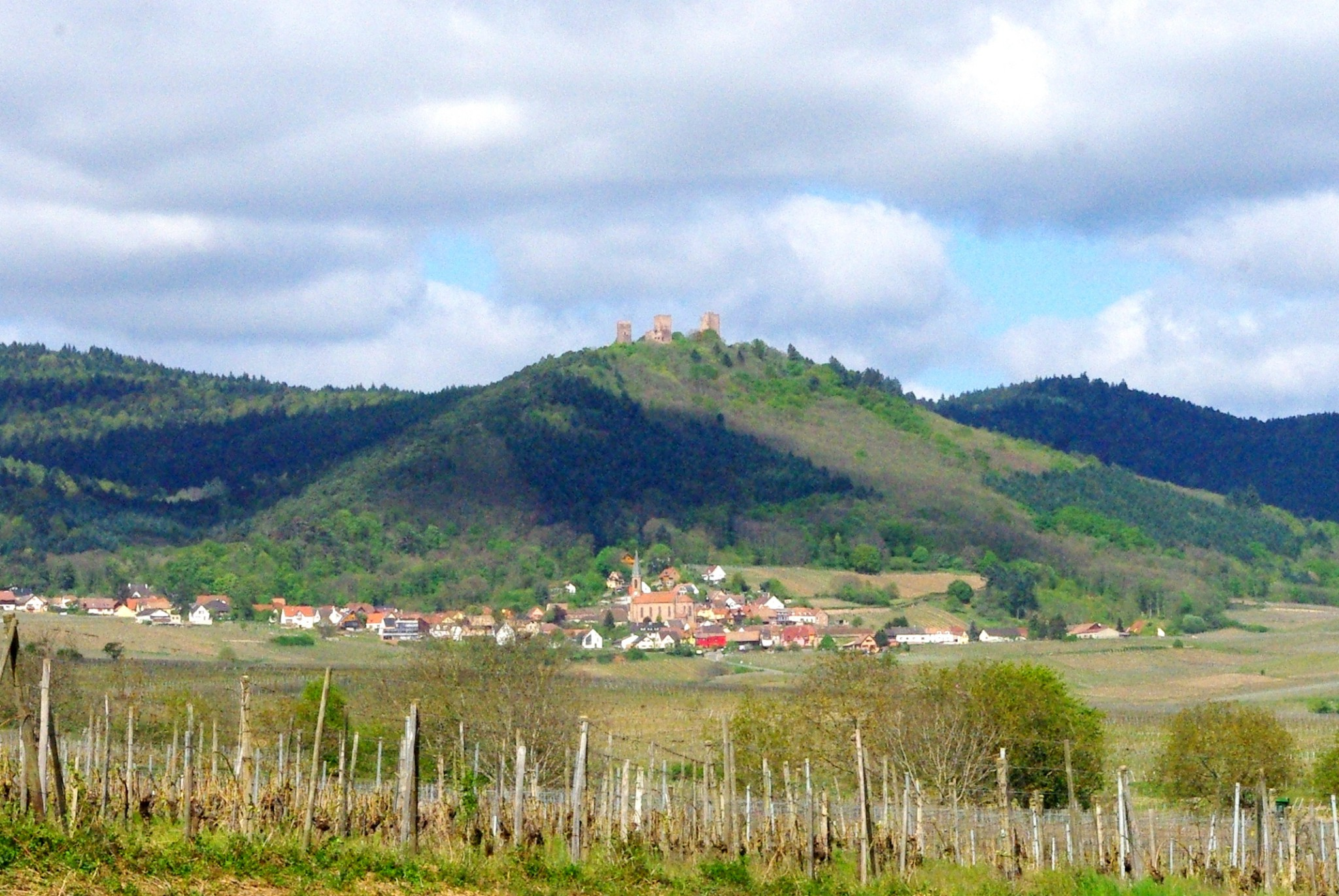 The three castles of Eguisheim seen from the vineyards © French Moments