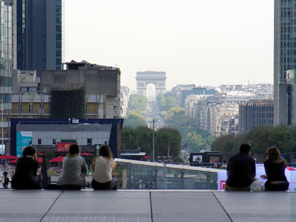The Arc de Triomphe seen from the Grande Arche de La Défense © French Moments