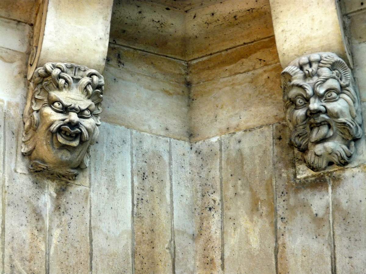 Mascarons on Pont-Neuf Paris © French Moments