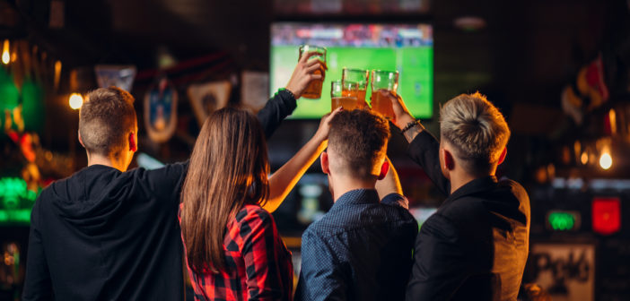 Friends watching football. Photo by NomadSoul1 @ Envato Elements