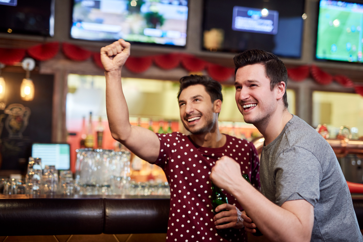 Watching football competition in Paris Sports Bars. Photo by gpointstudio @ Envato Elements